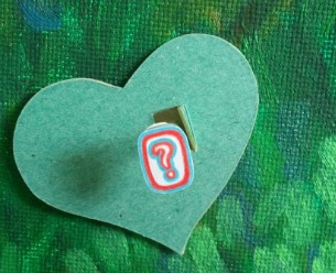 green heart with question mark front view, copyright www.doorway-to-self-esteem.com