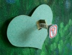 green heart with question mark